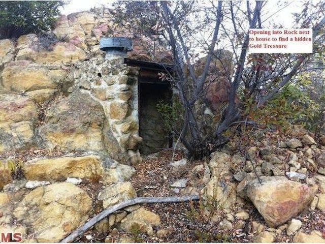 Buy This Cabin—And Get Its Secret Treasure Tunnels Free