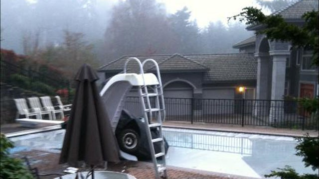 Drunk Man Crashes Vintage Toyota Into Swimming Pool