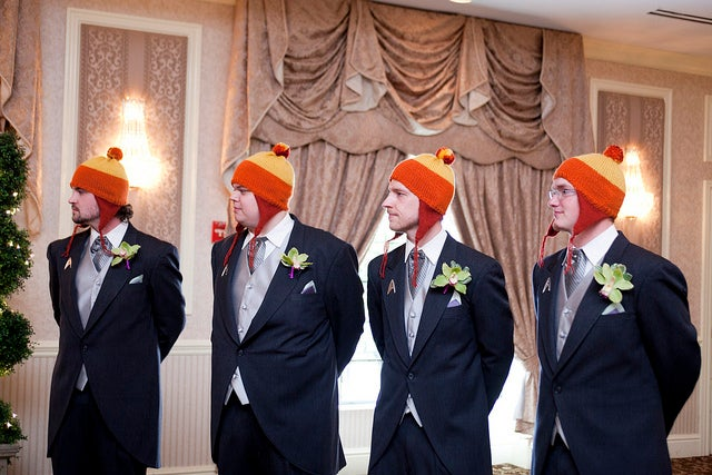 "Jayne hats on the groomsmen and ""Don't Panic"" invites make for a sweet and geeky wedding"