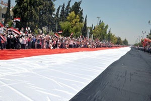 Assad Superfans Unfurl 'Biggest Syrian Flag' Ever