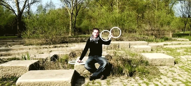 Wizard juggler tricks people's minds with a ring of illusions