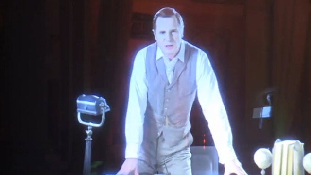 Behold Liam Neeson as the 3D holographic narrator in the War of the Worlds musical