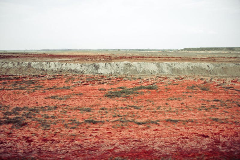 These photos from Hungary's 2010 toxic waste flood see half a world dyed red