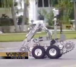 Standoff Climaxes When Suspect Shoots Bomb-Squad Robot In Face
