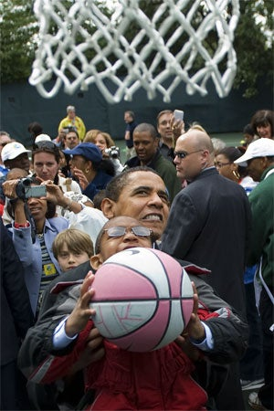 President Plays Hoops; Wins Polls