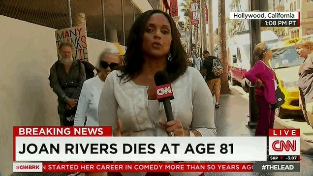 Man Does Money Sign In Background Of CNN's Joan Rivers Death Report