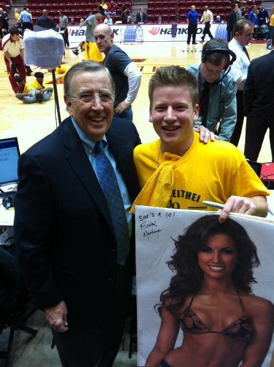 """She's A 10!"": Brent Musburger Signs Poster Of Katherine Webb"