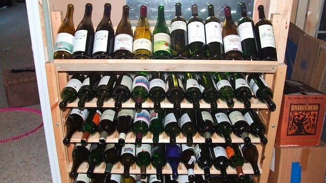 Repurpose an Old IKEA Bed into a Huge, 60-Bottle DIY WIne Rack