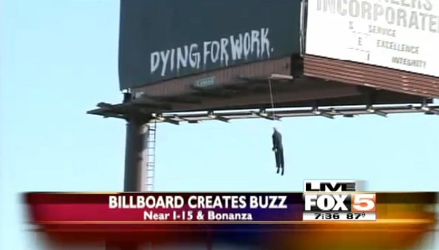 Las Vegas Drivers Distracted by 'Unemployed Men' Hanging from Highway Billboards
