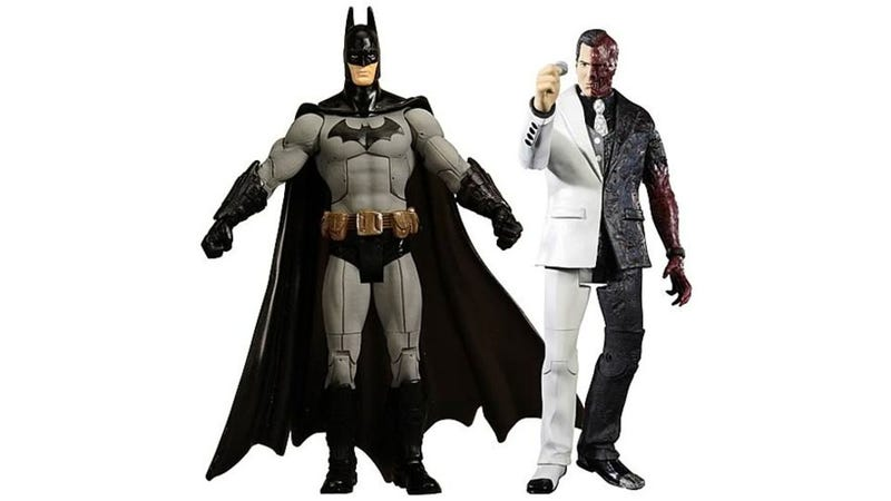 A Pair Of Batman Toys Escape From Arkham City