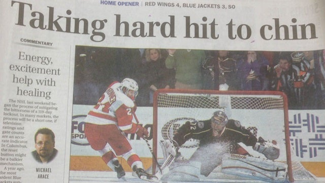 "Headline Above Newspaper's Blowjob Pantomime Photo: ""Taking Hard Hit To Chin"""