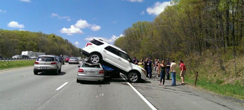 This SUV Landed On Top Of This Volvo And Nobody Was Hurt
