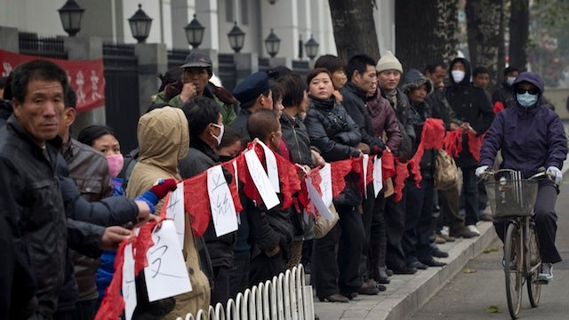 HIV-Positive Chinese Teachers Fight For Right To Work