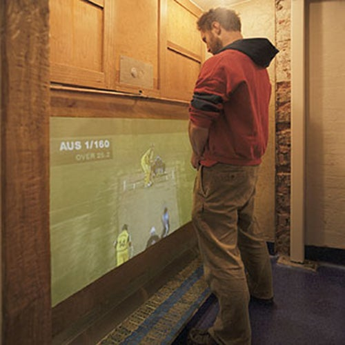 Rear-Projection Urinal Lets You Pee Over Football Games or Bill O'Reilly