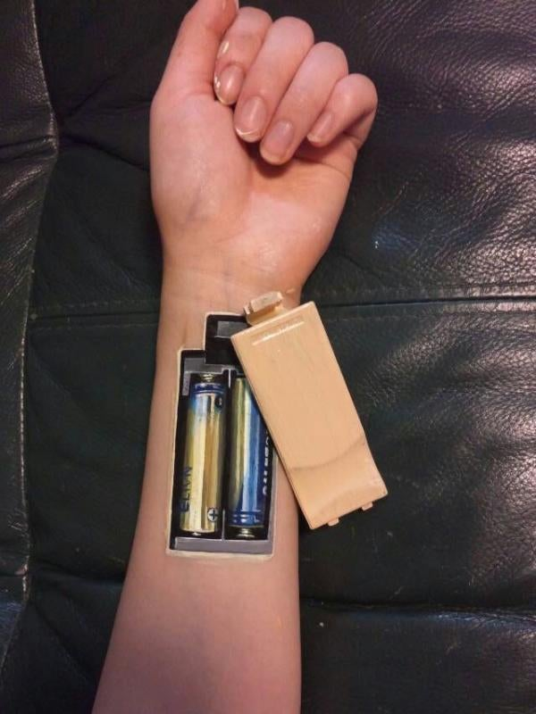 The Girl with Batteries in Her Arm and a Mouth on Her Hand
