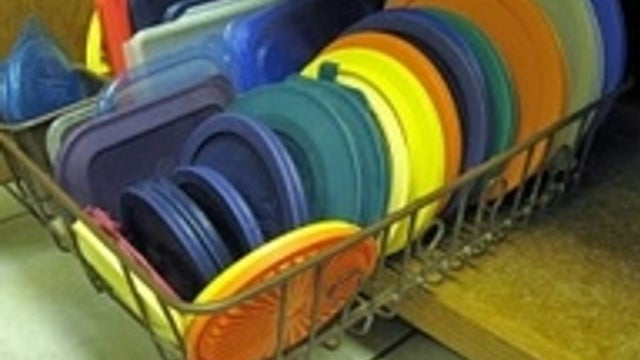 Use a Dish Rack to Organize Tupperware and Pot Lids