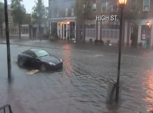 Someone Save This Aston Martin From Rising Waters