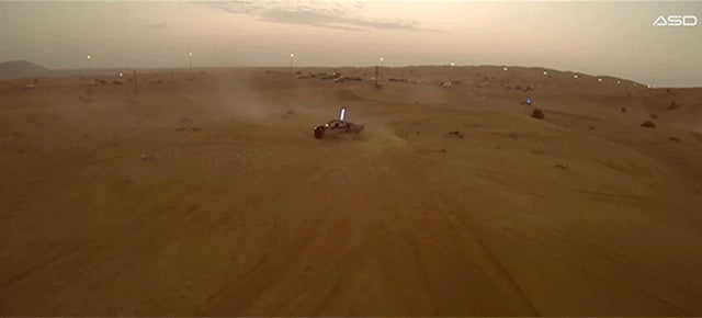 Dune buggies race on the verge of crashing in spectacular aerial video
