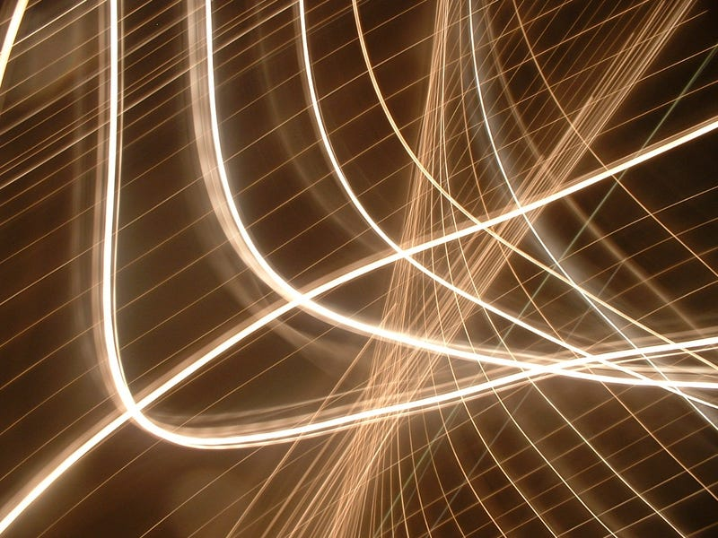 Create Abstract Light Art by Snapping a Camera-Toss Photo