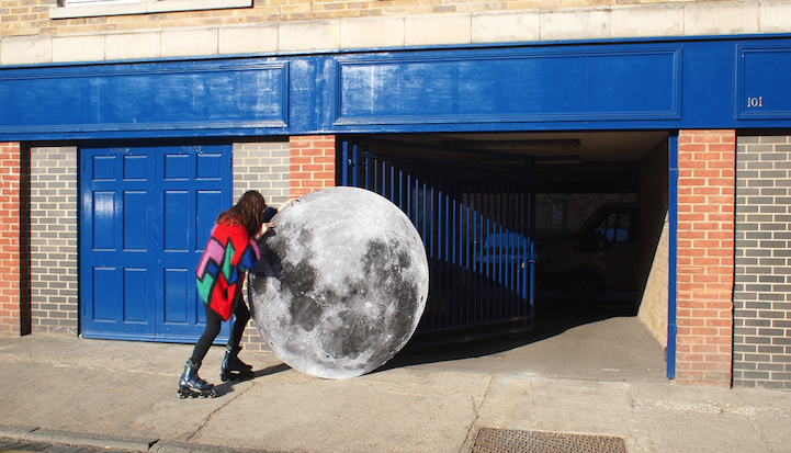 Artist takes her pet moon out for a walk