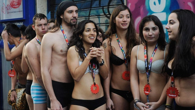 Spanish Shoppers Show Some Skin To Score Free Clothes