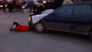 Car Plows Through Group of Ferguson Protestors