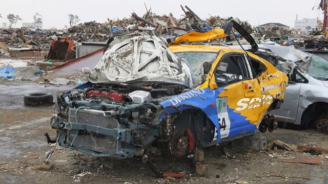 Did looters take the wheels from this Tsunami-devastated racecar?
