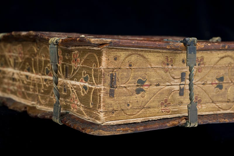 This beautifully bound book is actually six different texts in one