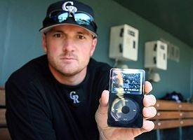 Baseball Players Using iPods To Scout Opposing Teams