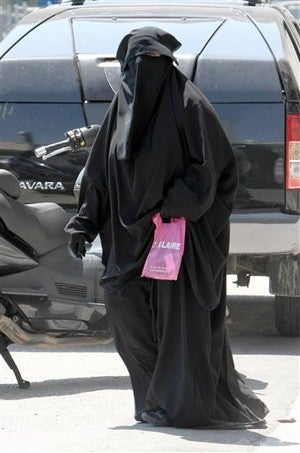 France May Ban The Burqa • Couple With Swine Flu Weds