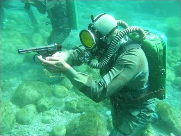Scuba Diving In A War Zone? Better Bring Your Underwater Gun!