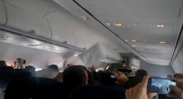Watch a Pillow Fight Spontaneously Erupt on an Airplane