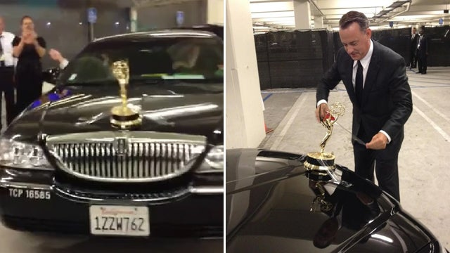 Tom Hanks Has So Many Emmys He Uses Them For Hood Ornaments