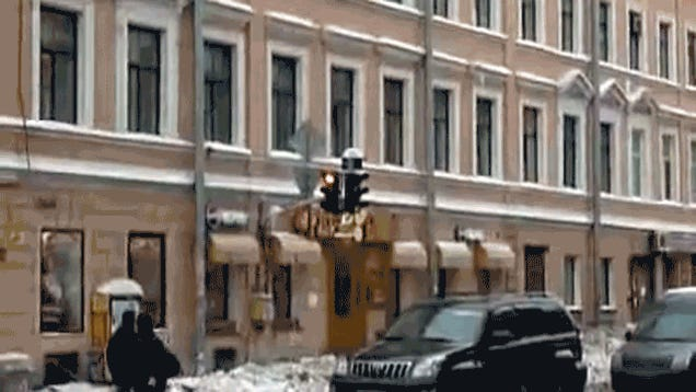 Giant Russian Icicle Big Enough To Crush Traffic Light