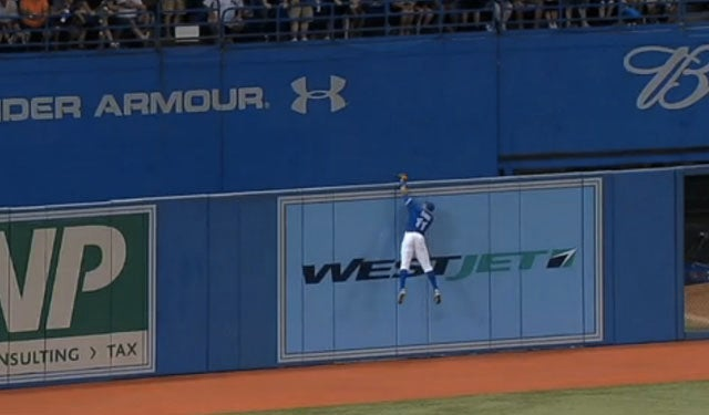 Rajai Davis Goes Above The Rogers Centre Outfield Wall For A Home Run-Robbing Catch