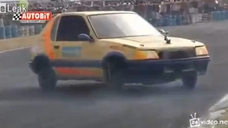 Watch A Peugeot 205 Spin Some Hilariously Fast Donuts