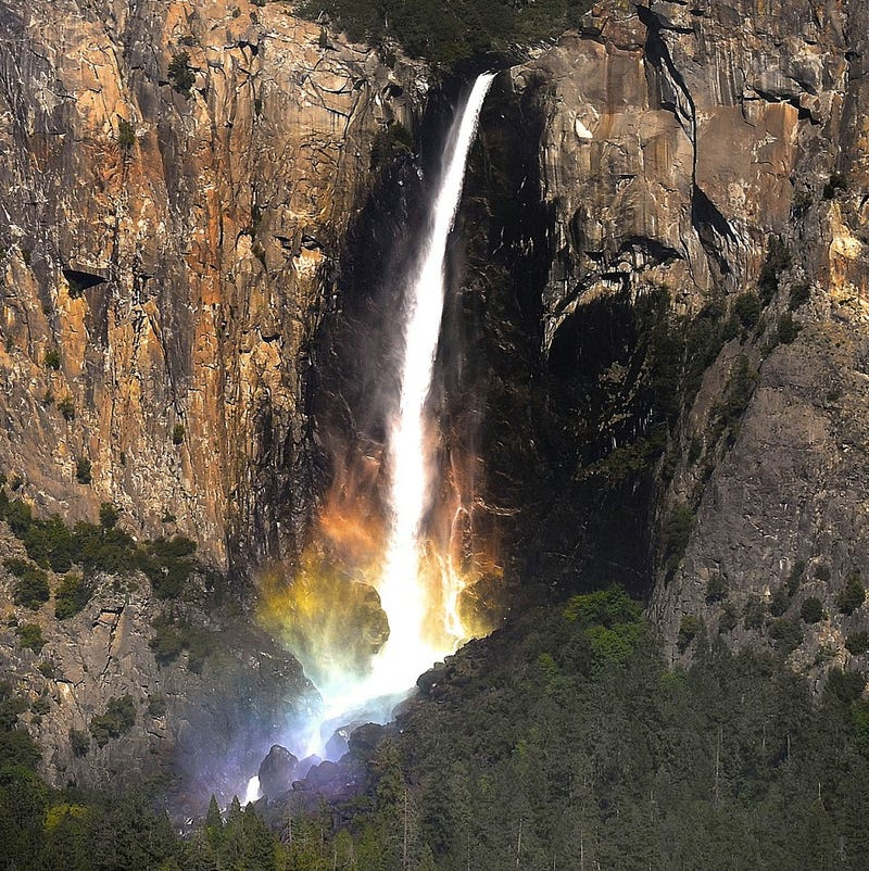 Many leprechauns died to bring us this gorgeous picture of a rainbow waterfall