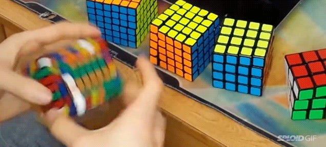 Watch this guy breaking a Rubik's Cube world record at insane speed