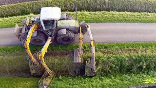Watching this octopus tractor mowing a roadside ditch is hypnotizing