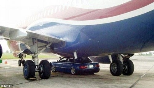 Crazed Nigerian Wedges Car Under Airplane In Sad Terror Attempt