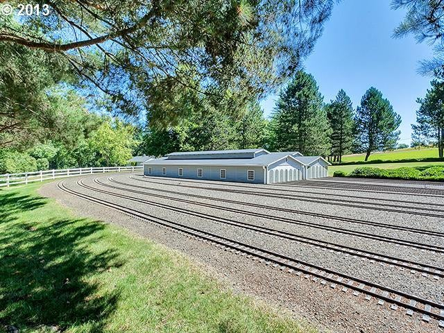 This house has a freaking train you can ride all around the property