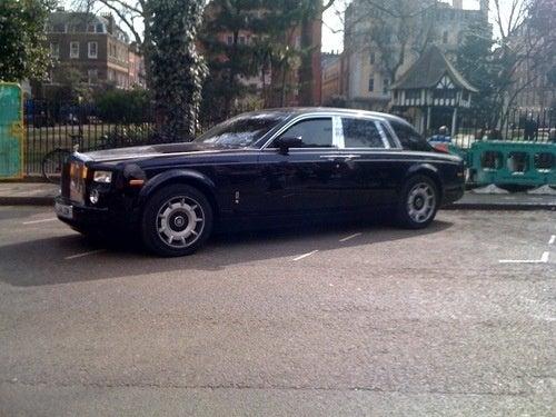 How Many Spots Does It Take To Park A Rolls-Royce Phantom?