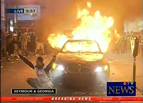 "Woman who defended BMW from Vancouver rioters was ""total stranger"""