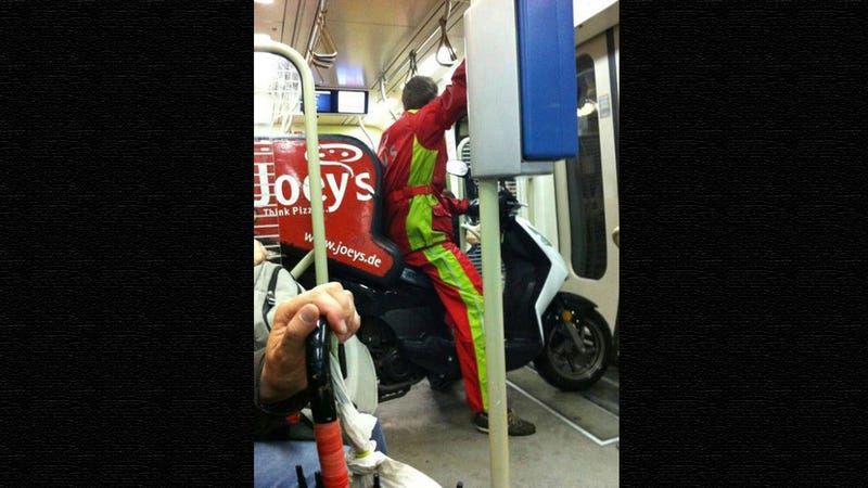World's Laziest Pizza Delivery Guy Takes The Subway On His Scooter [Update]