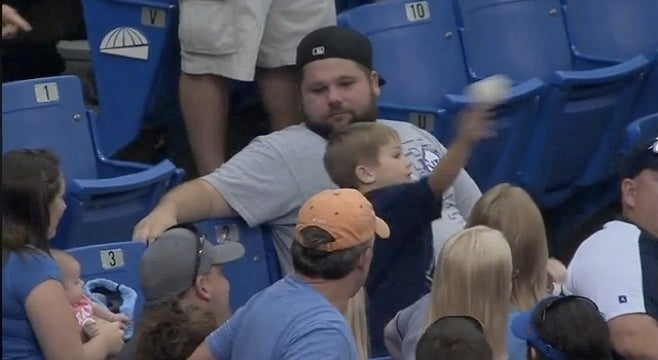 Man Gives Child Baseball, Child Tries To Throw Baseball Back