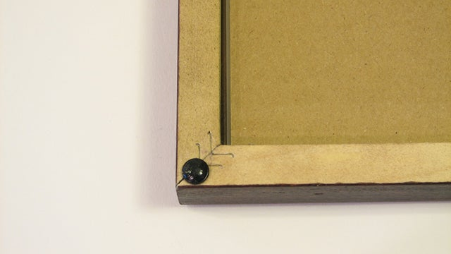 Use Rubber Feet to Keep Picture Frames Straight