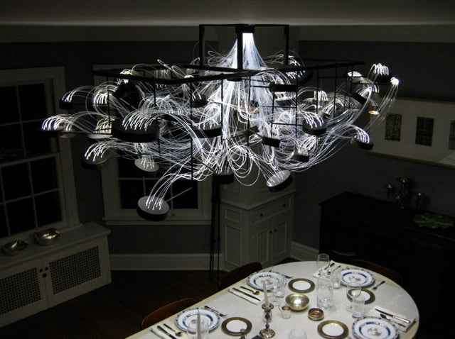 A chandelier made from petri dishes that actually grows bacteria