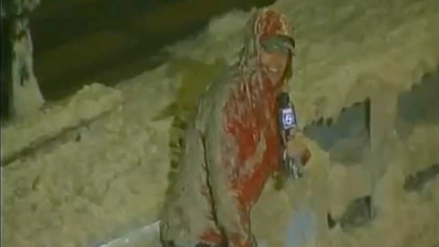 Watch a Weather Man Get Covered in What's Probably Raw Sewage