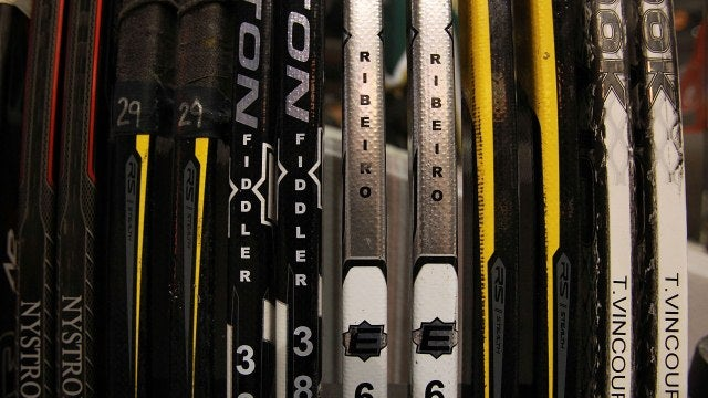$85. That is the cost of each hockey stick the University purchases for its varsity players.