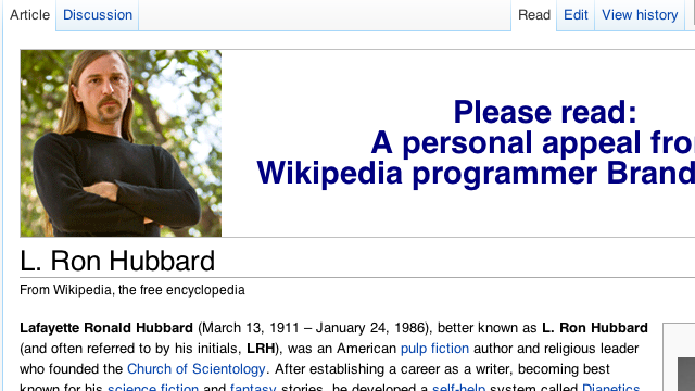 That Creepy Guy With the Mustache At the Top of Wikipedia Speaks